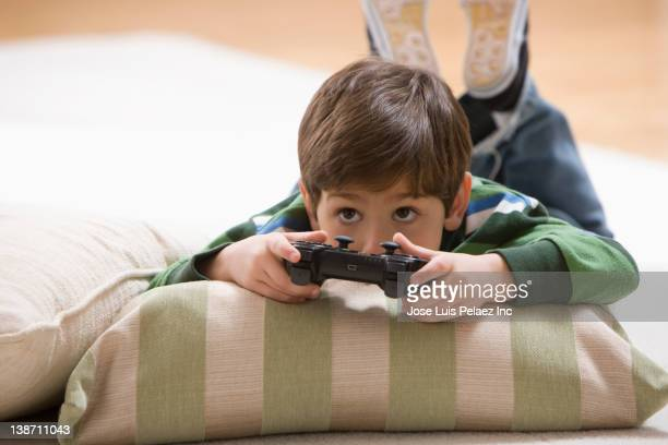 Caucasian boy playing video game
