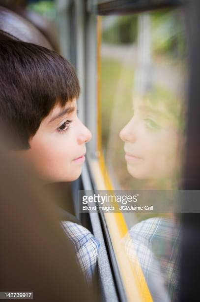 Caucasian boy riding school bus