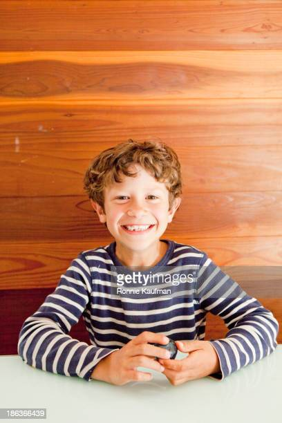 Caucasian boy smiling at table