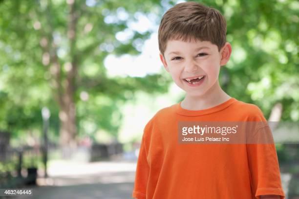 Caucasian boy smiling outdoors