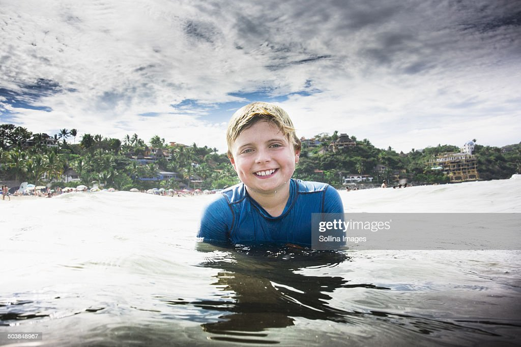 caucasian boy swimming in ocean foto de stock getty images
