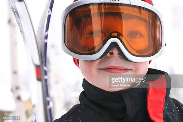 Caucasian boy wearing ski gear in snow
