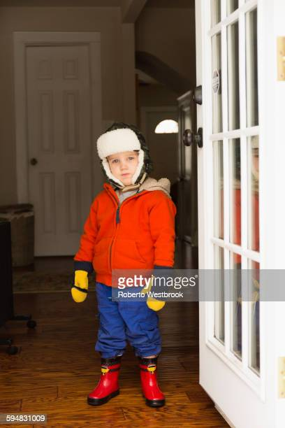 Caucasian boy wearing snow gear