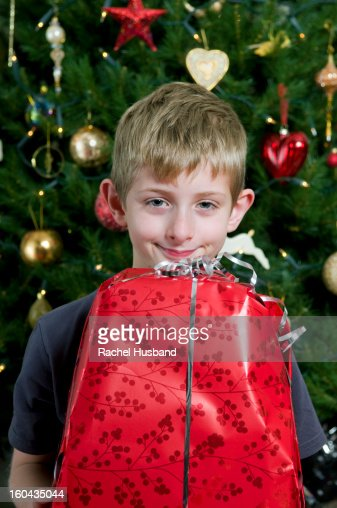 Caucasian boy with a Christmas present : Stock Photo