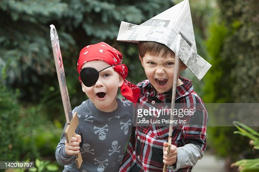 Caucasian boys playing pirates