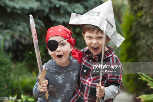 Caucasian boys playing pirates