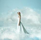 Caucasian bride in clouds