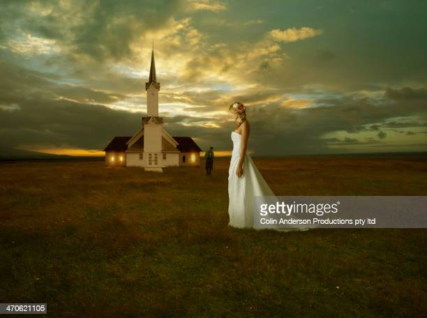 Caucasian bride standing outside church