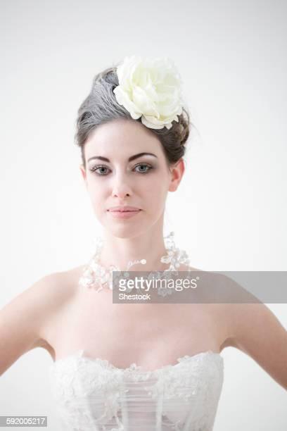 Caucasian bride wearing flower and birdcage veil
