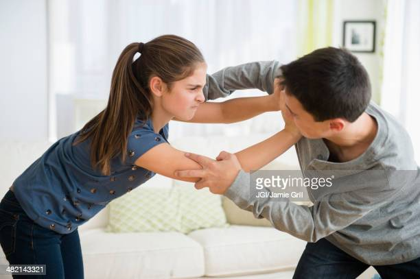 Caucasian brother and sister fighting