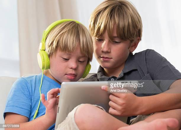 Caucasian brothers using digital tablet