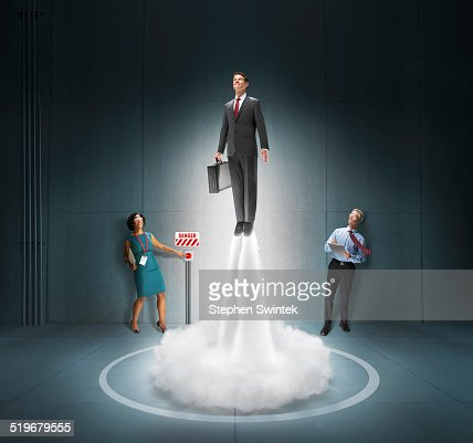 Caucasian business man blasting off like rocket