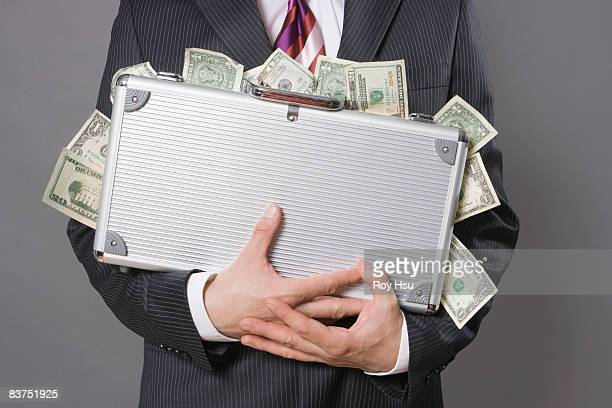 Caucasian business man with case of money