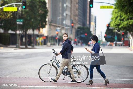 Caucasian business people crossing city street