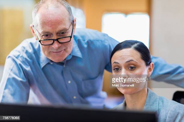 Caucasian business people reading computer