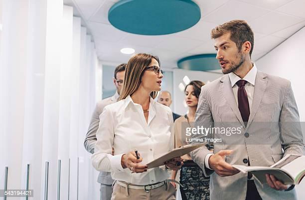 Caucasian business people talking in office