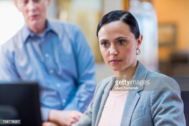 Caucasian business people using computer