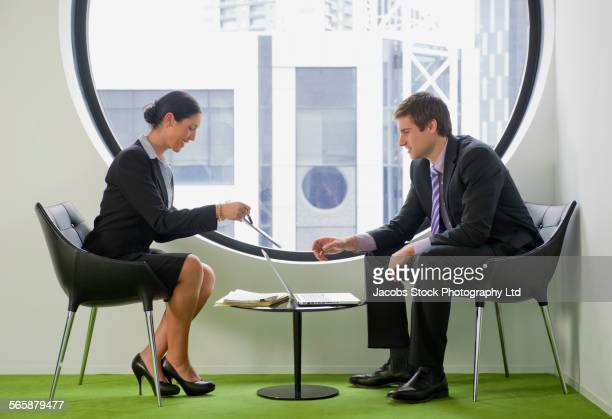 Caucasian business people working in office waiting area