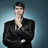 Caucasian businessman caught in the rain