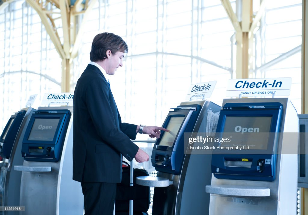 Caucasian businessman checking-in at airport