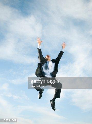 Caucasian businessman jumping in air : Stock Photo