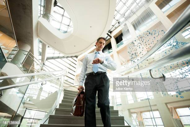 Caucasian businessman on office steps
