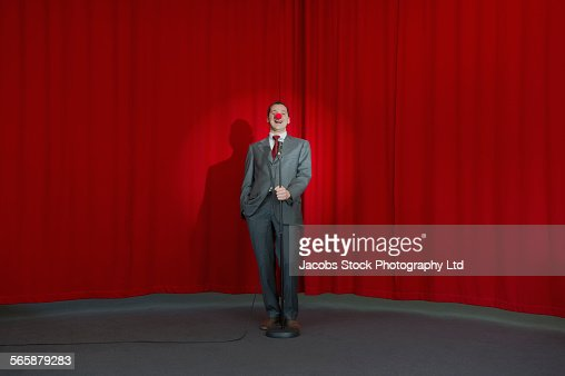 Caucasian businessman performing comedy on stage