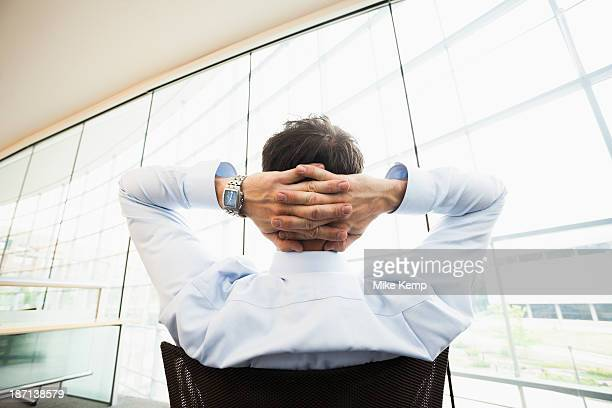 Caucasian businessman relaxing at desk