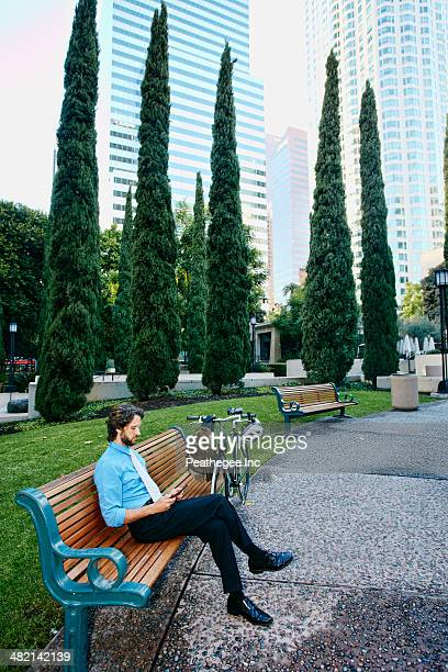 Caucasian businessman relaxing in urban park