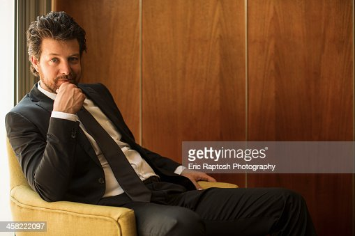 Caucasian businessman sitting in armchair