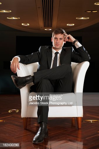 Caucasian businessman sitting in chair thinking