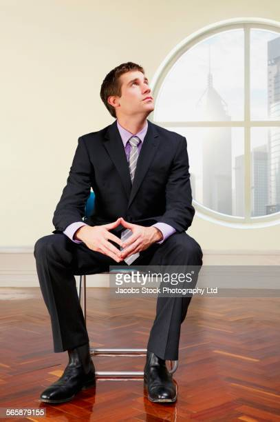 Caucasian businessman sitting in office near window