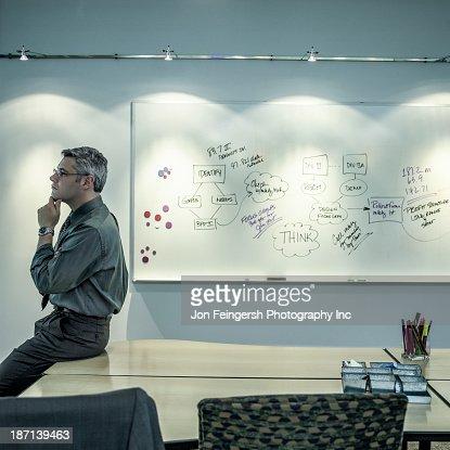 Caucasian businessman sitting on desk