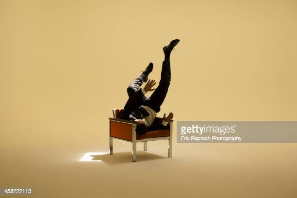 Caucasian businessman sitting under spotlight