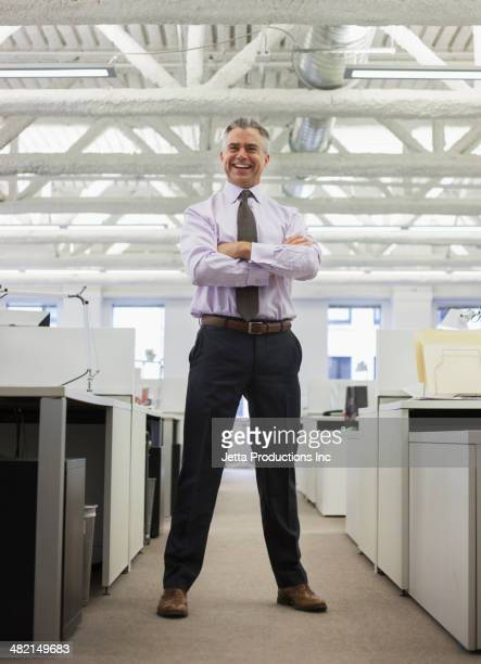 Caucasian businessman smiling in office