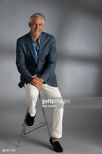 Caucasian businessman smiling on stool