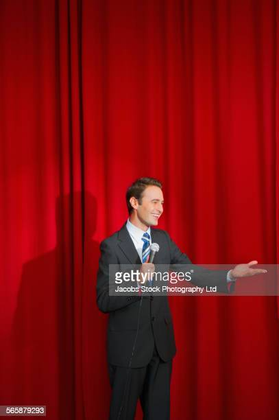 Caucasian businessman speaking on stage