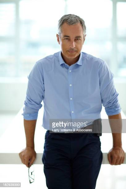 Caucasian businessman standing in office
