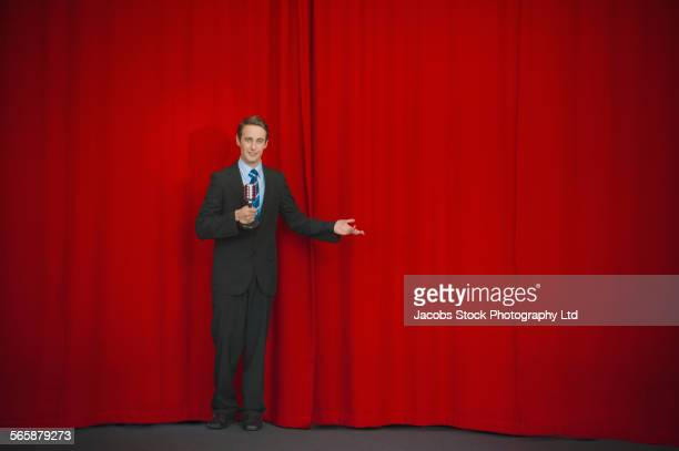 Caucasian businessman standing on stage
