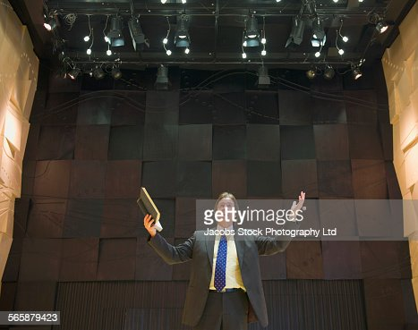 Caucasian businessman talking on stage