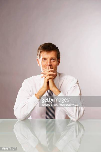 Caucasian businessman thinking at table