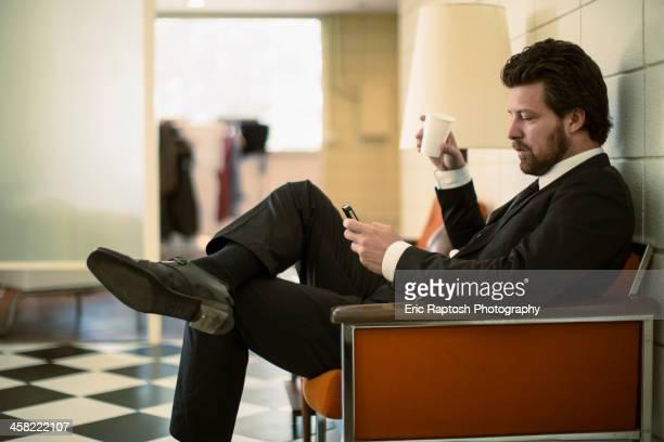 Caucasian businessman using cell phone