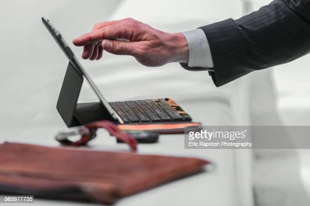 Caucasian businessman using digital tablet