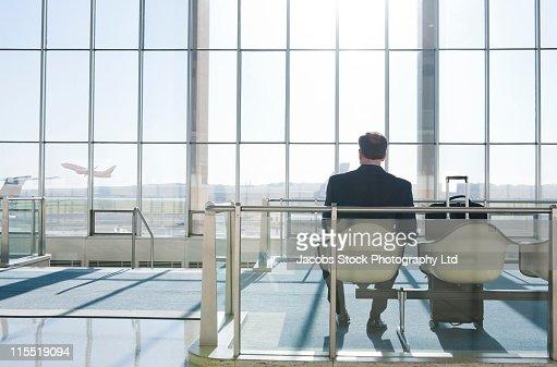Caucasian businessman waiting in airport