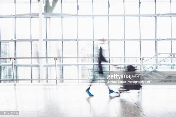 Caucasian businessman walking in airport