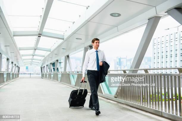 Caucasian businessman walking on walkway