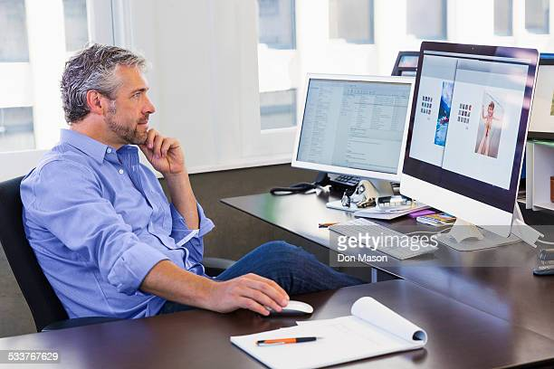 Caucasian businessman working at computer in office