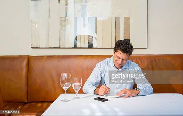 Caucasian businessman working at restaurant