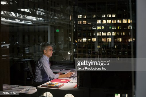 Caucasian businessman working late in office