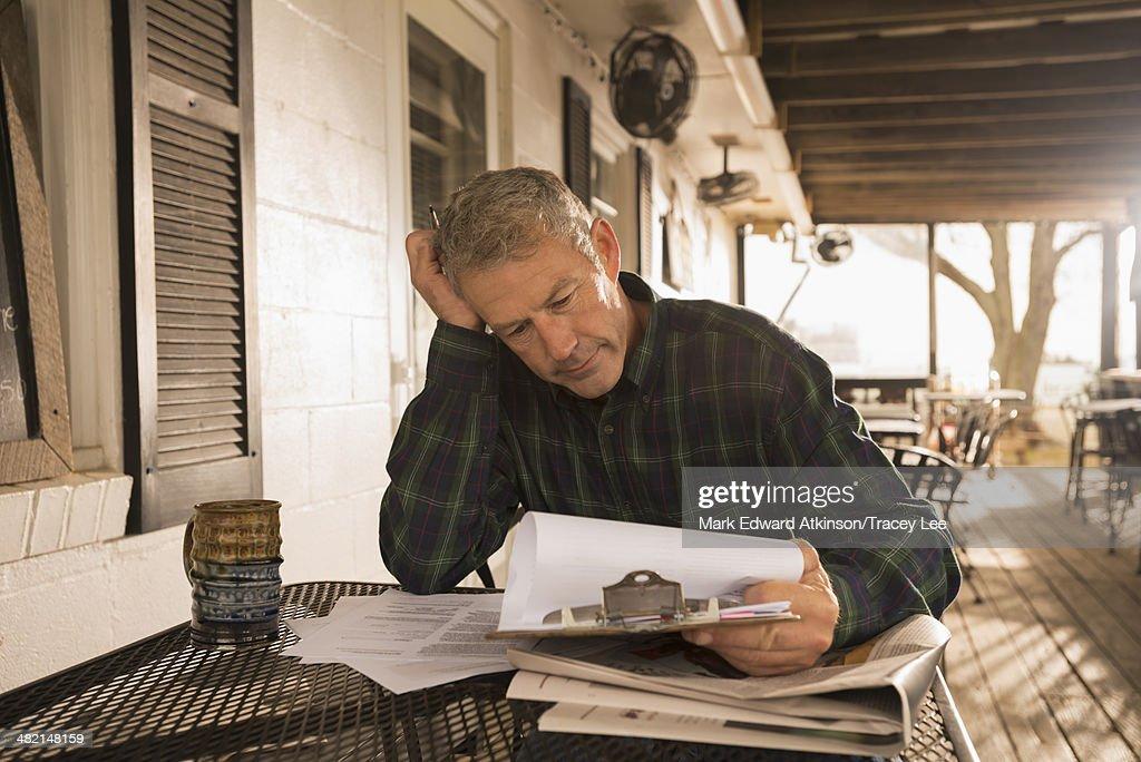Caucasian businessman working on patio